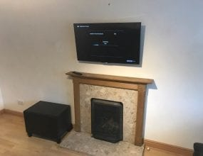 Wall mounted TV above fireplace