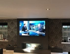 Wall mounted TV in home