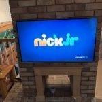 Big Wall mounted TV on chimney breast