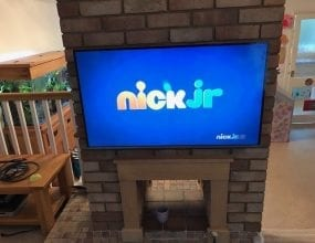 Big Wall mounted TV on chimney breast
