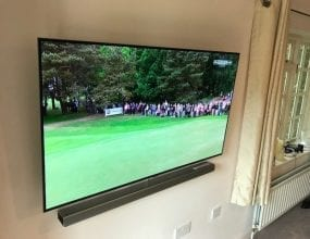 Big Wall mounted TV in home